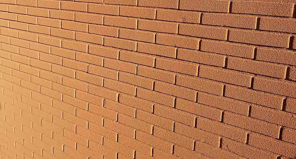 Instalación de corcho proyectado en fachadas, suelos y terrazas